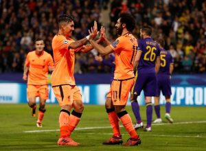 Firmino & Salah celebrate their goal fest